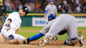 DETROIT, MI - SEPTEMBER 19: Ian Kinsler #3 of the Detroit Tigers is tagged out at home plate by catcher Salvador Perez #13 of the Kansas City Royals to end the ninth inning of the tied game  on September 19, 2015 at Comerica Park in Detroit, Michigan. (Photo by Leon Halip/Getty Images)